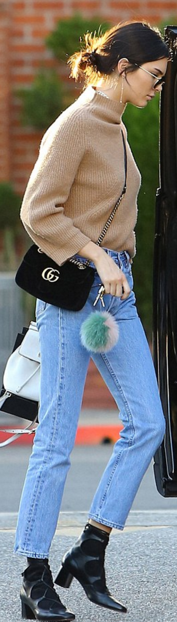 21cd4ae4ea85db Kendall Jenner': Purse and shoes – Gucci Key Chain – Fendi Jeans – Re/done  Sunglasses – Garrett Leight Backpack – Dolce & Gabbana