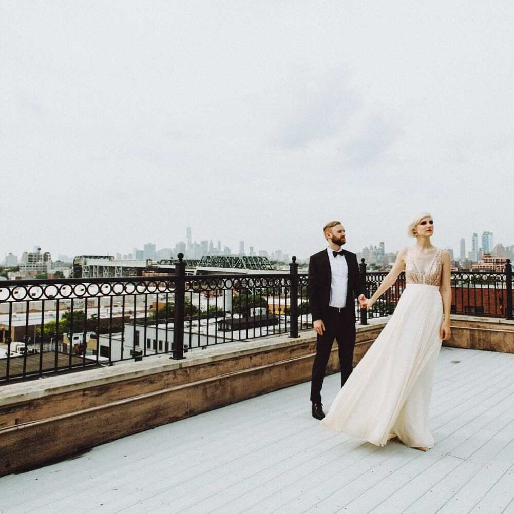 NYC rooftops and our Eden dress. This setting belongs to our Brooklyn stockist @schonebride and is making me wish I was either back in Gowanus or had that view from our Vancouver studio. So captivating . Photography : @ambergressphotography // by truvellebridal