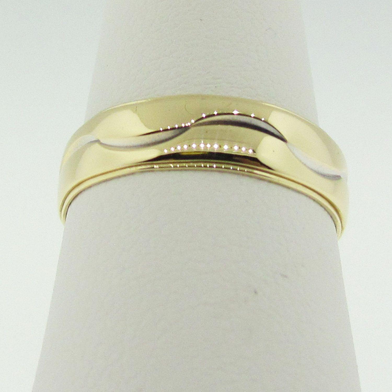 Vintage 14 K gold wedding band design by ARTCARVED. by