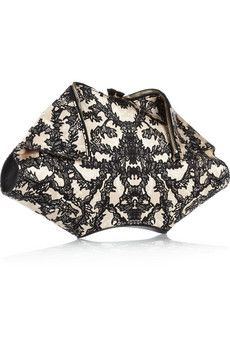 I've never seen this type of clutch but it's awesome, obviously made by Alexander McQueen