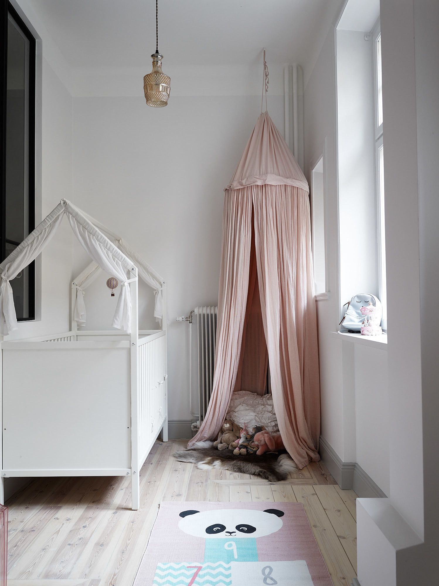 Adorable White Little Girls Room With Panda Rug, Pink Canopy,