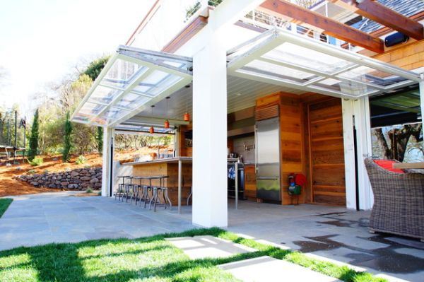 Sectional Glass Garage Doors Used In Modern Designs | Glass garage ...