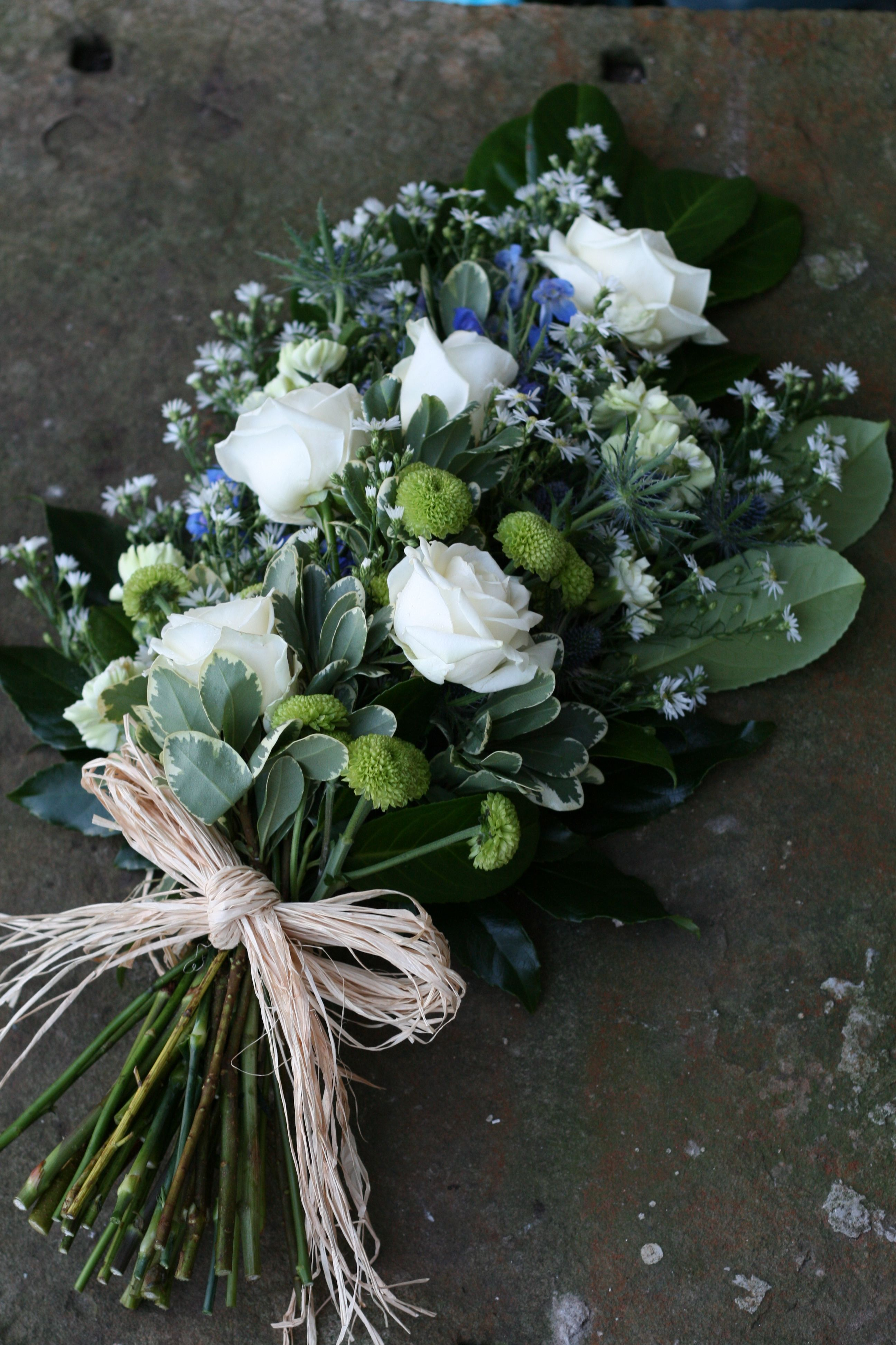 Cream Rose And Blue Thistle Sheaf Funeral Tribute An Elegant