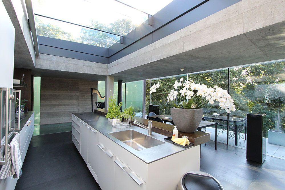 Our sliding over roof skylights bring in a continuous for Large skylight