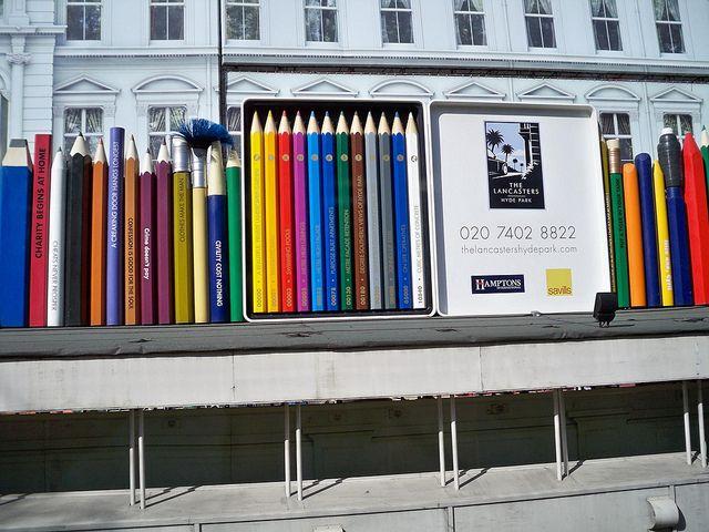 Building hoardings taken from a coach window hoarding