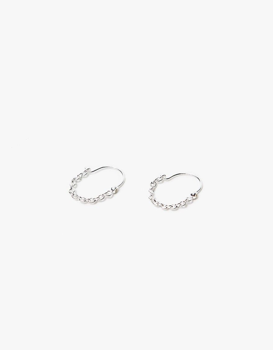 From Pamela Love, a pair of sterling silver earrings with chain link detailing…