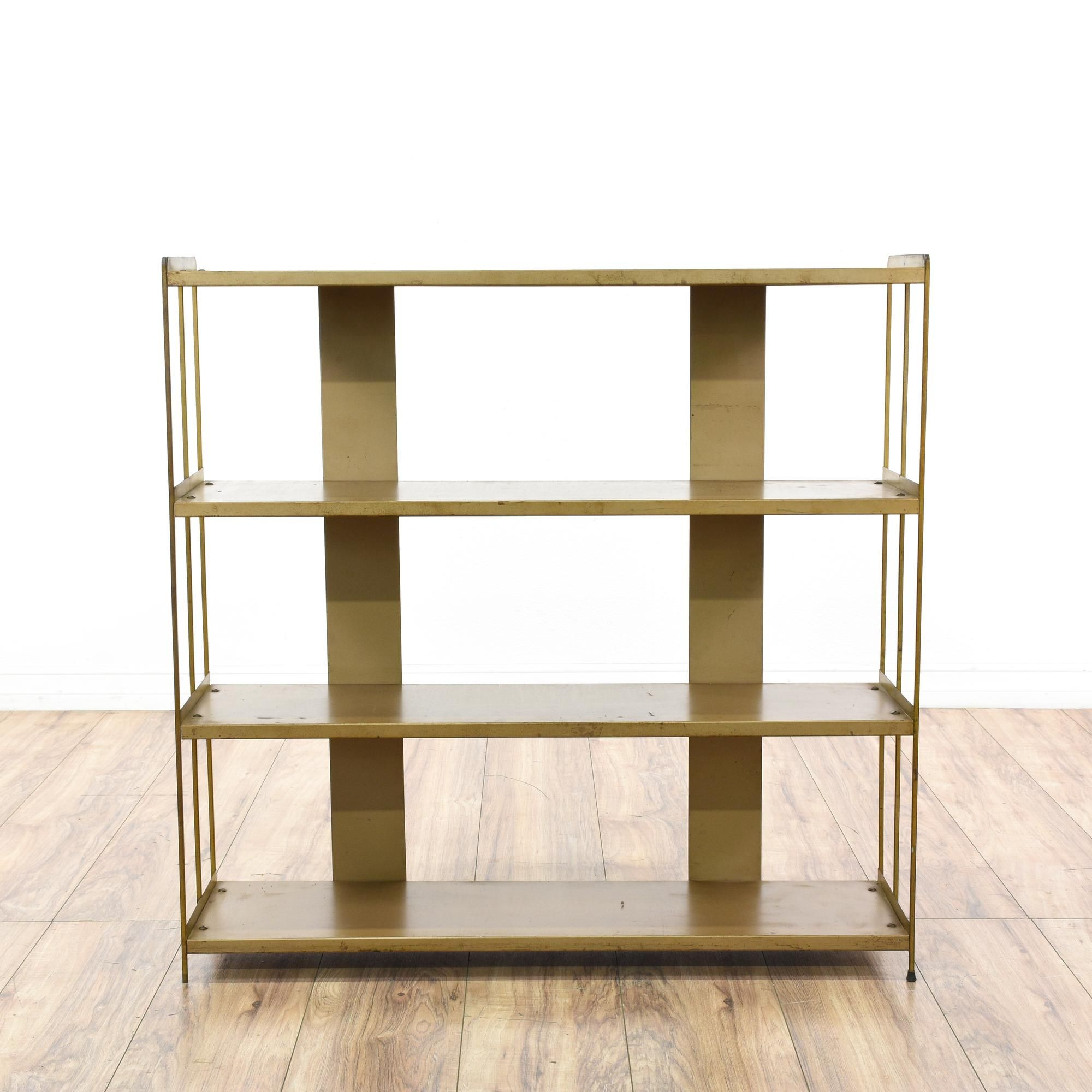 This mid century modern bookshelf is featured in a durable metal