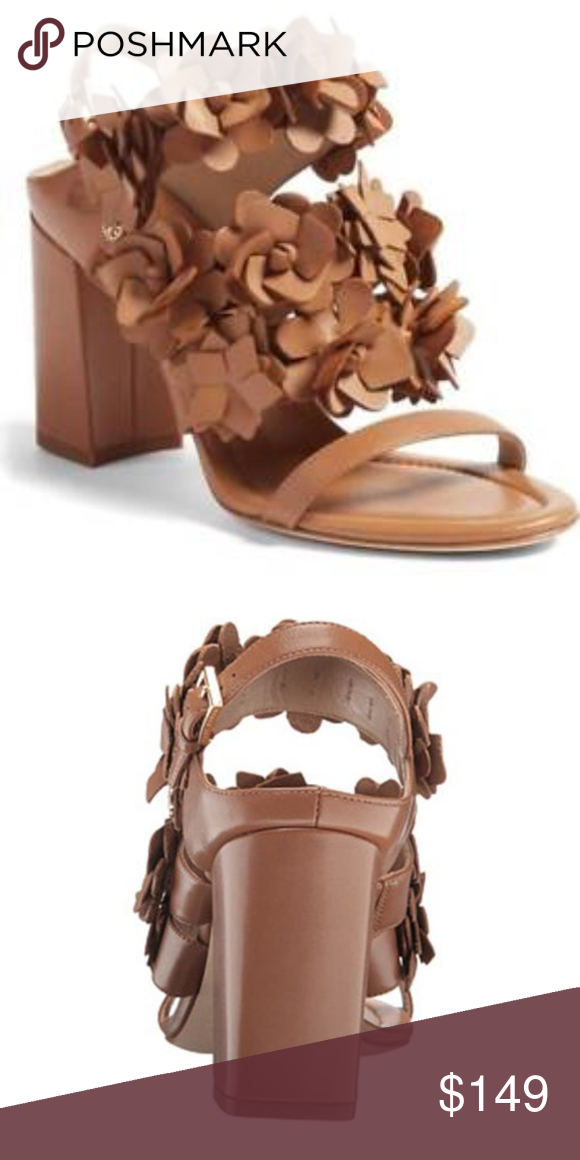 bca177297 Tory Burch Blossom 65MM Sandal in Royal Tan Feminine flowers and flattering  height combine on Tory s Blossom Sandal. Made of smooth napa leather