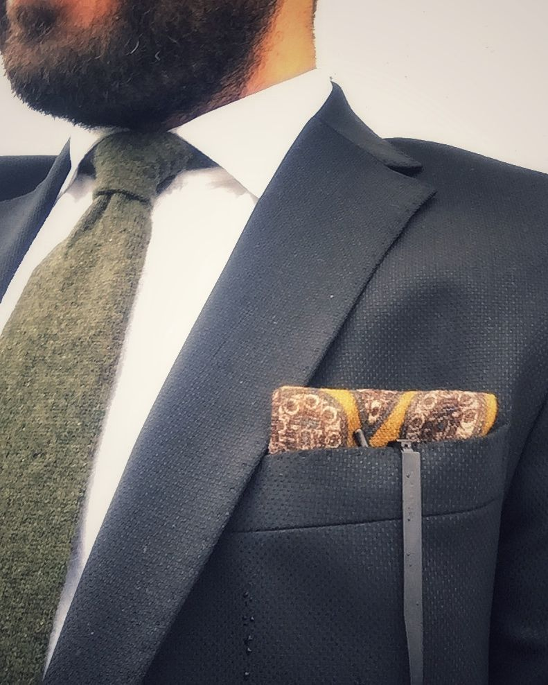 Berat's black blazer and pocket square outfits