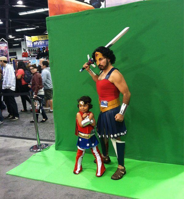 dad & daughter wonder women costumes. (omg so cute!  first the little girl, and then the awesome wonderwoman gladiator dad! go dad.)