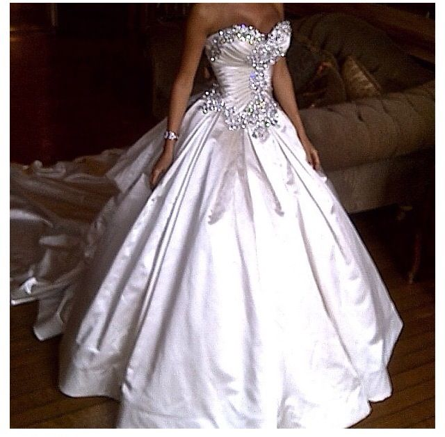 Pnina Tornai wedding dress adorned in beads, gems and crystals ...