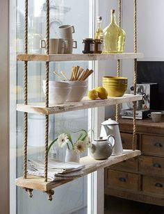 How cute is this! A little rope and lumber  by the foot and viola ... hanging rope shelves.
