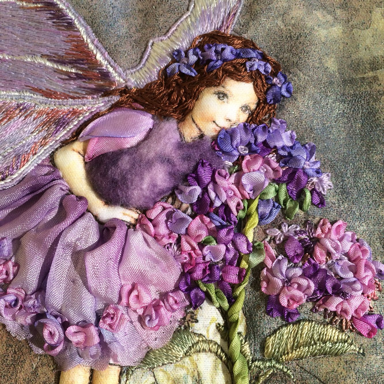 Heliotrope flower fairy close up. Threads and silk ribbon ...