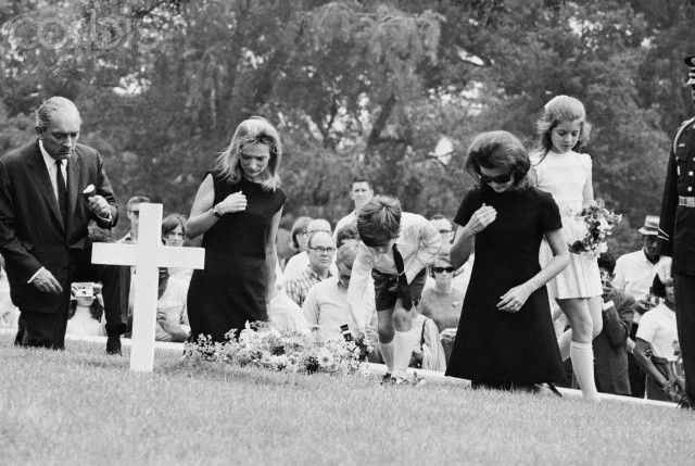 Jacqueline Kennedy and children at gravesite of the late President Kennedy. Arlington, Virginia