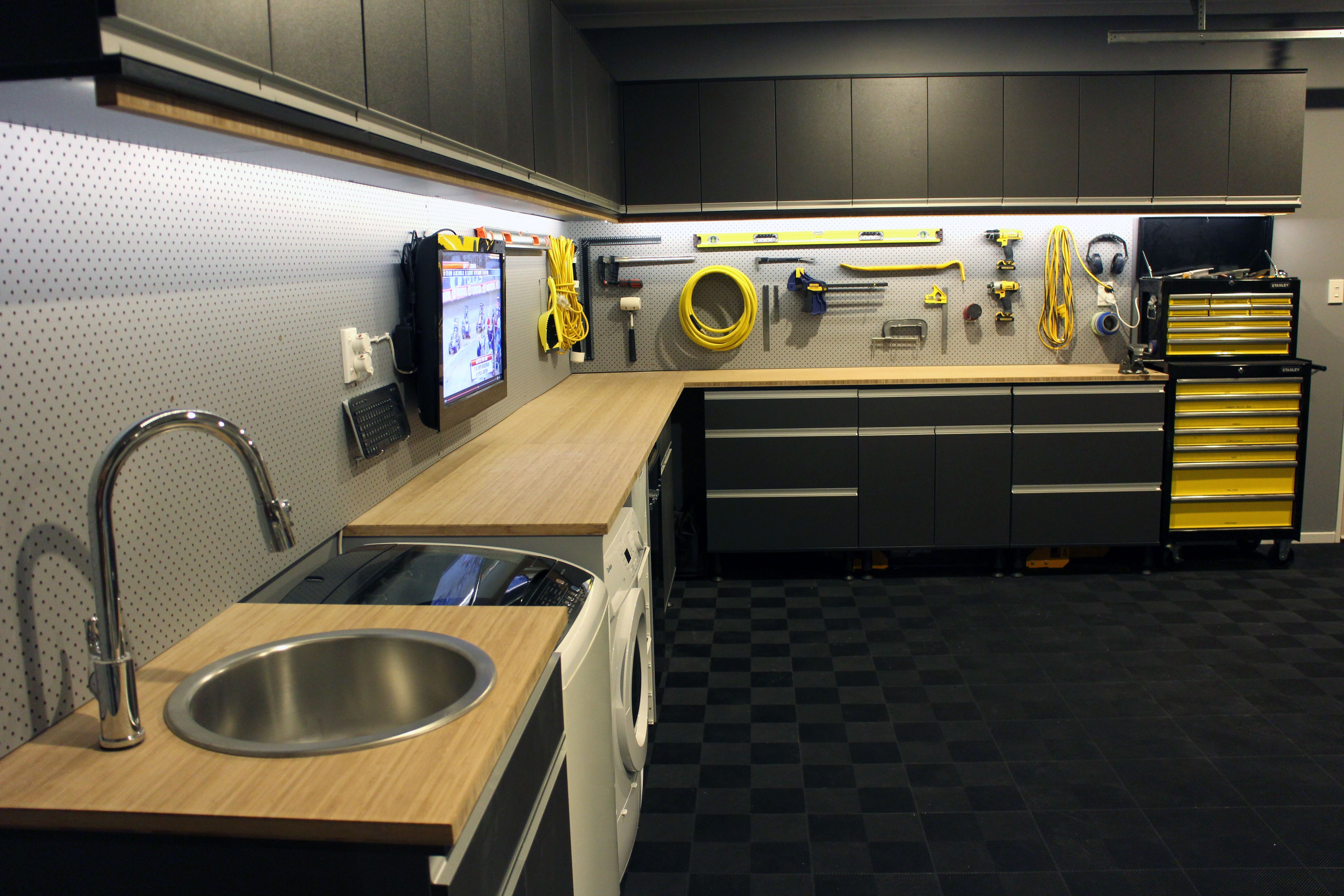 Photo of Workshop / Garage / Laundry storage with grey cabinetry, aluminium handles and p…