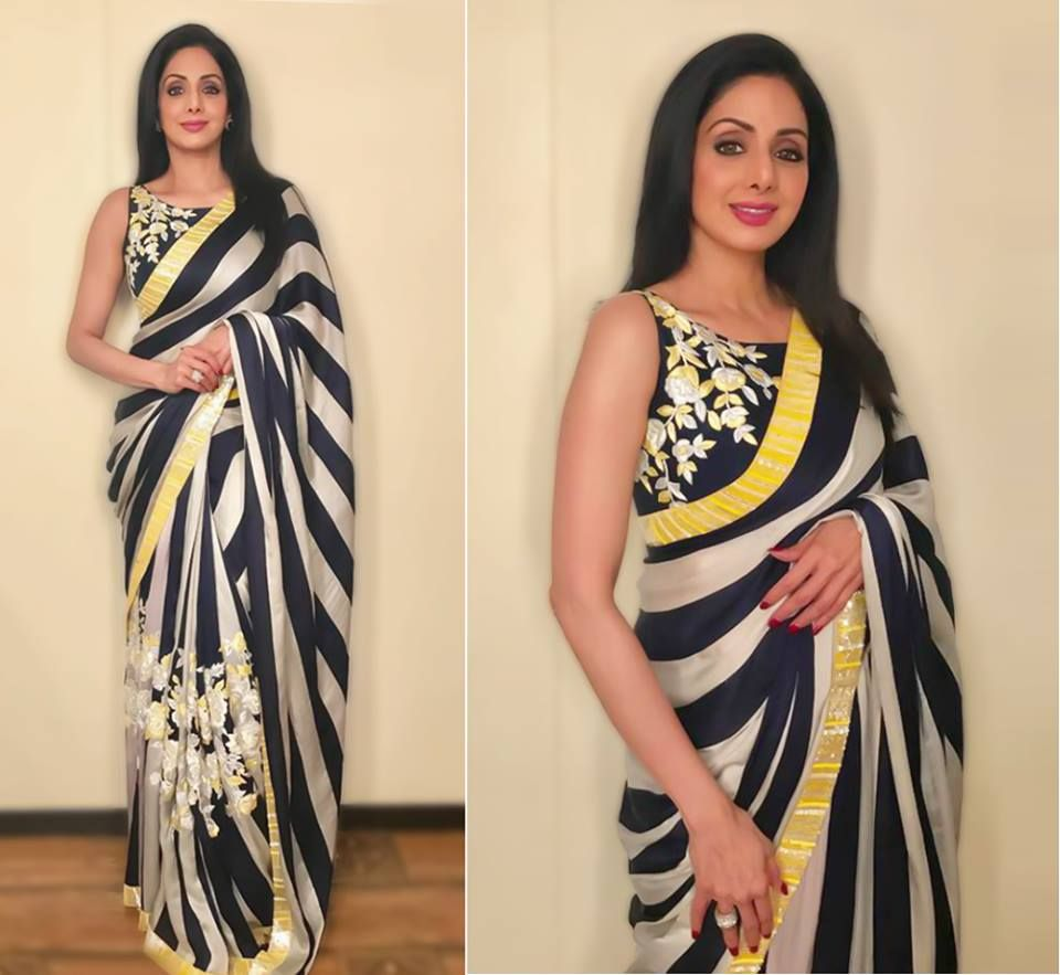 Sridevi Kapoor dressed in a magnificent striped Manish Malhotra saree with floral threadwork. Sridevi gracefully embodies the truest form of beauty.