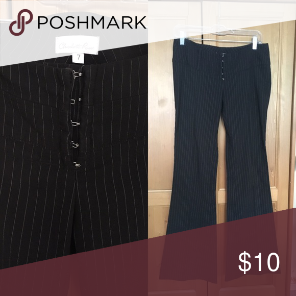 Charlotte Russe Pinstripe Pants Super cute size 7 Pinstripe work pants from Charotte Russe with a corset-like hook and eye front closure is sexy and flattering. The legs fit tight in thigh area and flare out a little. They show some wear along the waistband and along the hem but otherwise in good condition. Charlotte Russe Pants Trousers