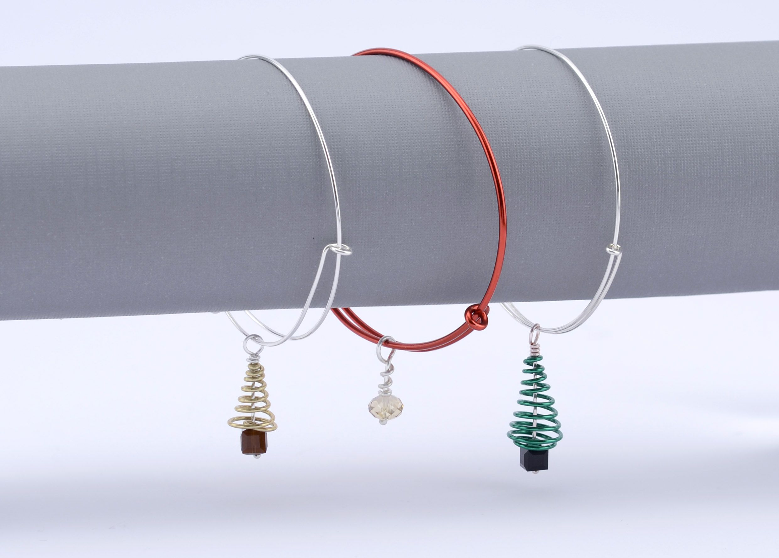 Wire wrapped adjustable charm bracelets made with Artistic Wire