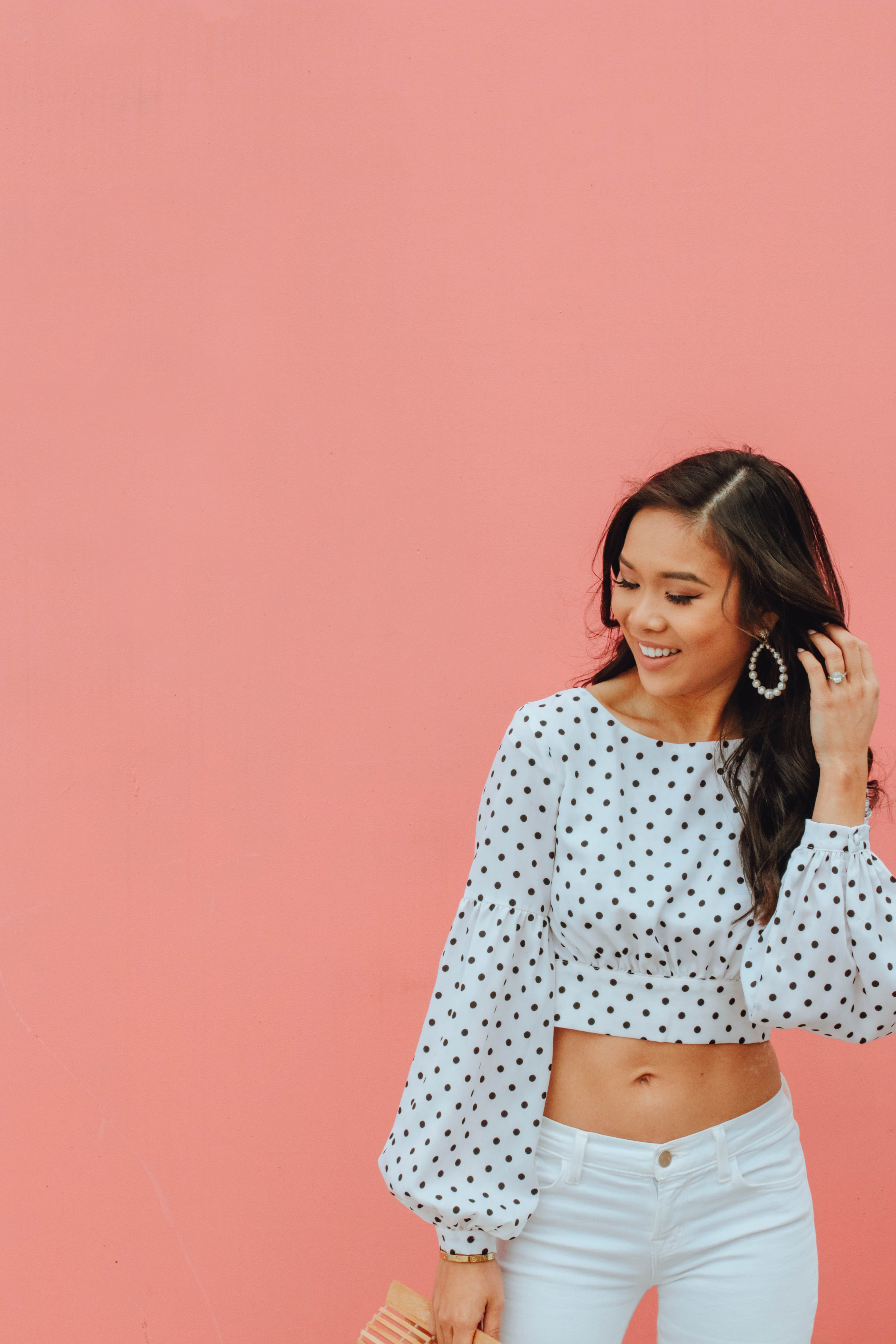 3b6b21ae337 Hoang-Kim wears a polka dot crop top with white jeans and olive + piper  earrings