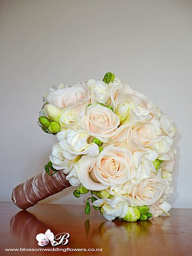 Bridal Posy Of Cream Vendela Roses And White Freesia Bound In Champagne Satin Ribbon