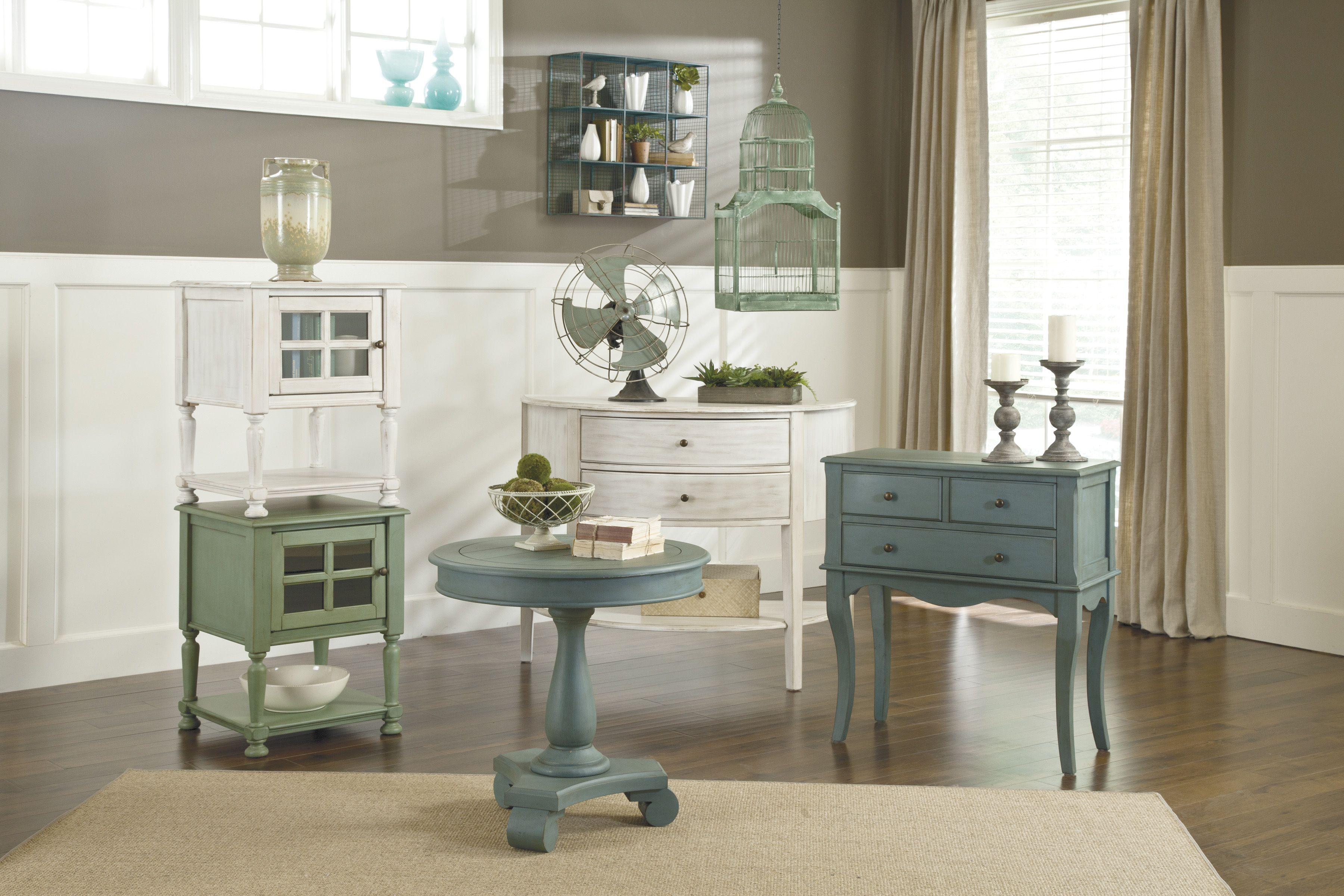 Rustic painted storage cabinets and small tables perfect for