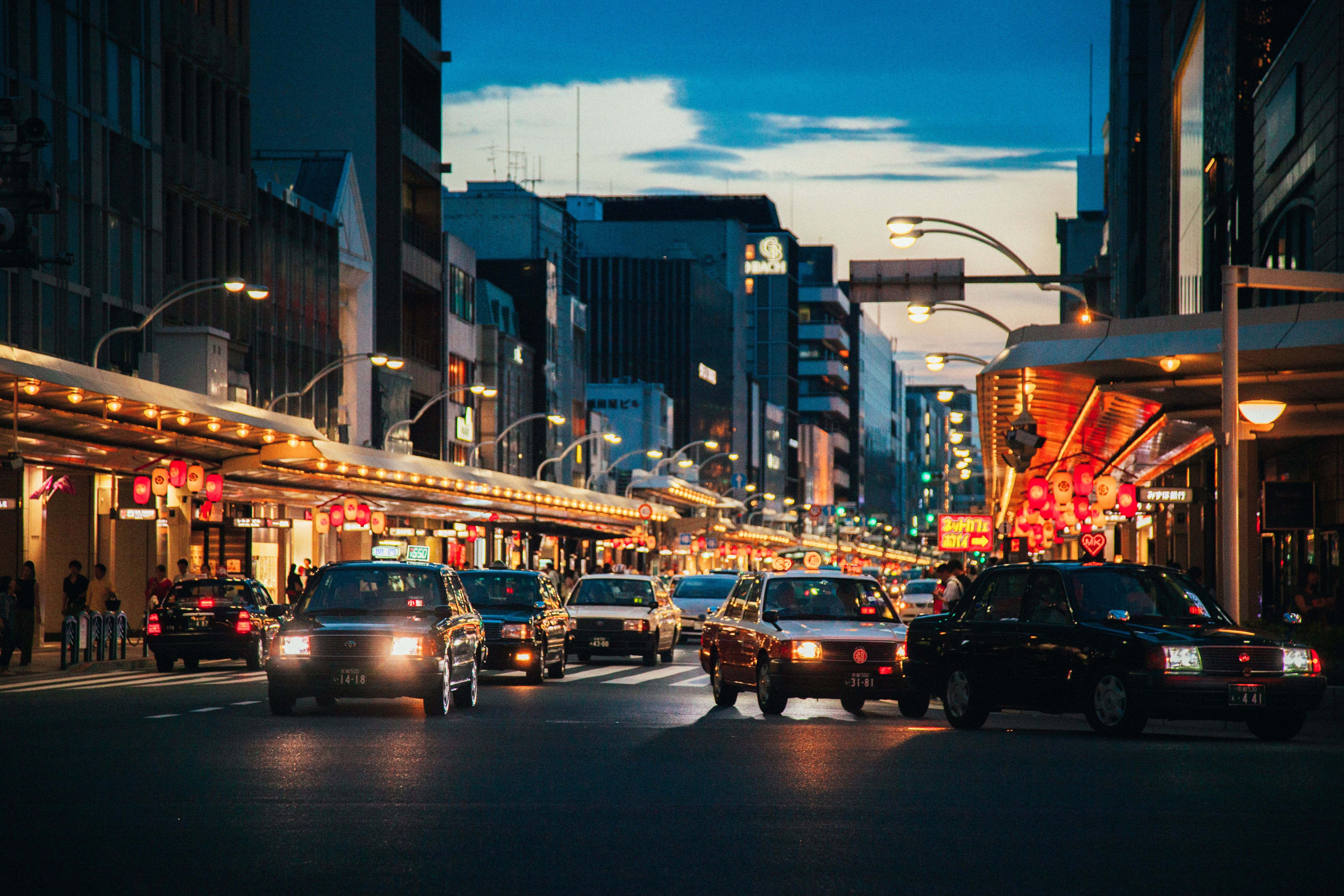 Car Vehicle Automobile Cars On Gray Cars On Gray Asphalt Road In The City During Nighttime Kyoto Car Photos Photo Kyoto City buildings road cars night street
