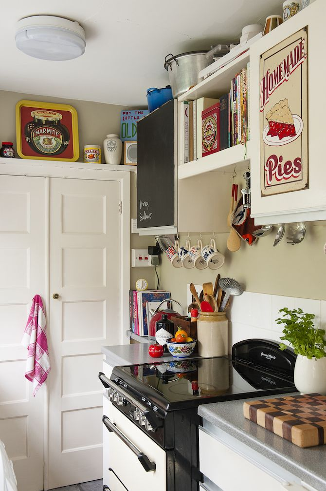 The Sweet Little Kitchen Is Decorated With Vintage Artwork Interiors Wtinteriors