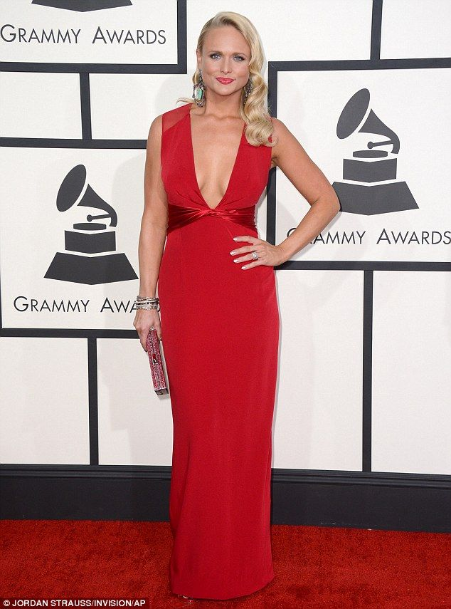 Jaw-dropping! Miranda Lambert looked better than ever as she posed in a slimming red gown at the Grammy Awards on Sunday night at the Stapes...