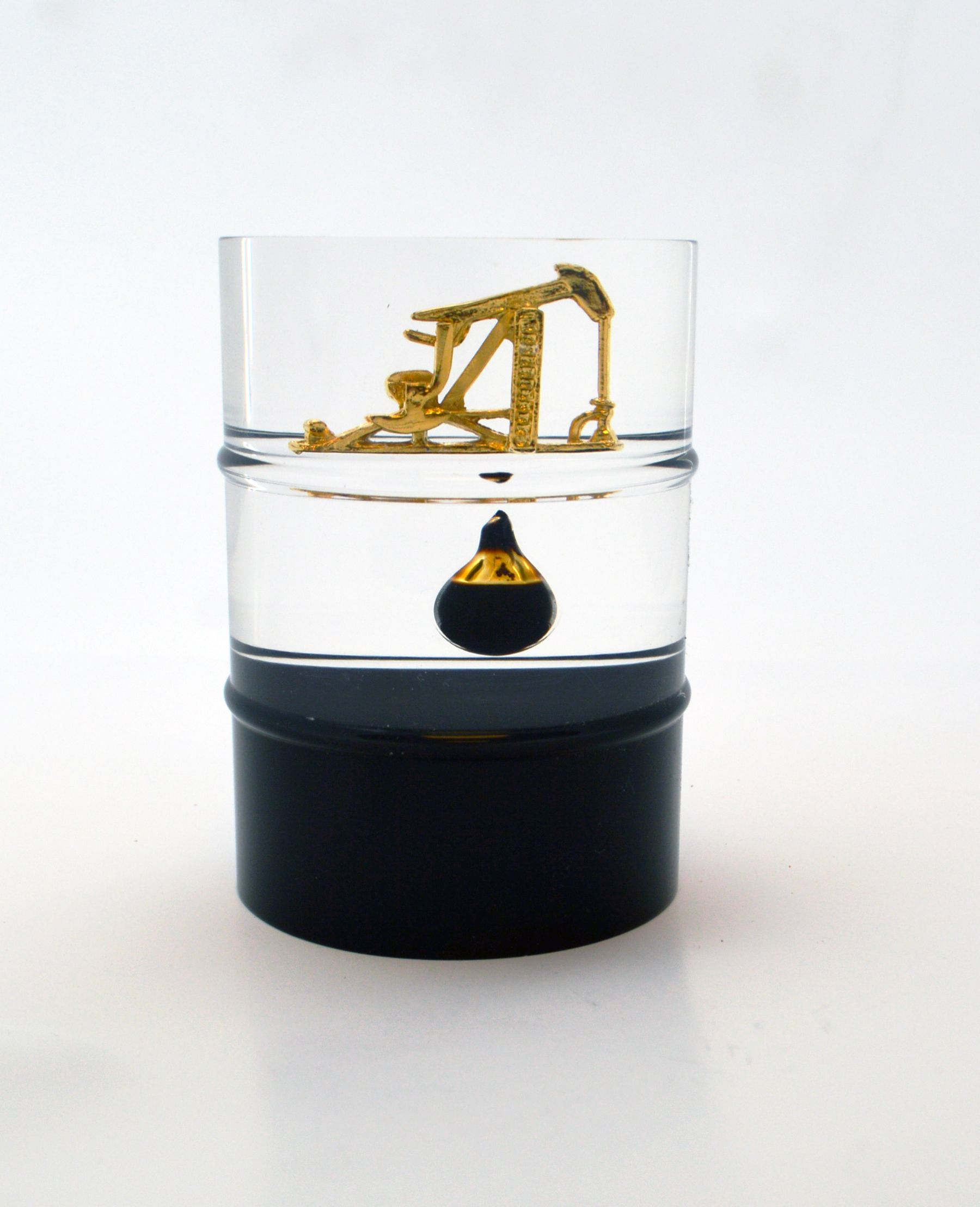 Lucite 3D Oil Barrel with metal cast of pump jack, an oil drop, and a black bottom. Lucite financial deal toys, embedments, and acrylic awards to promote your deal, announcement, company, or event. http://www.lucitetombstones.com/lucite_idea_gallery.htm 401-841-5646 #luciteembedments #dealtoys #lucitetombstones #lucite