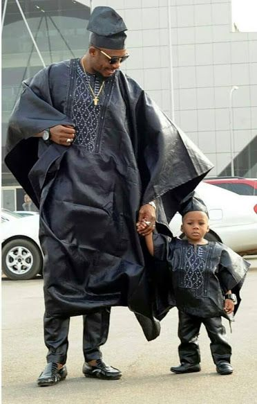 African father and son wearing matching outfits!