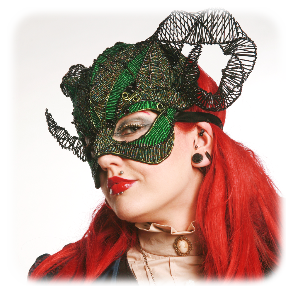 Green and black horned mask by Grin, Grimace and Squeak!