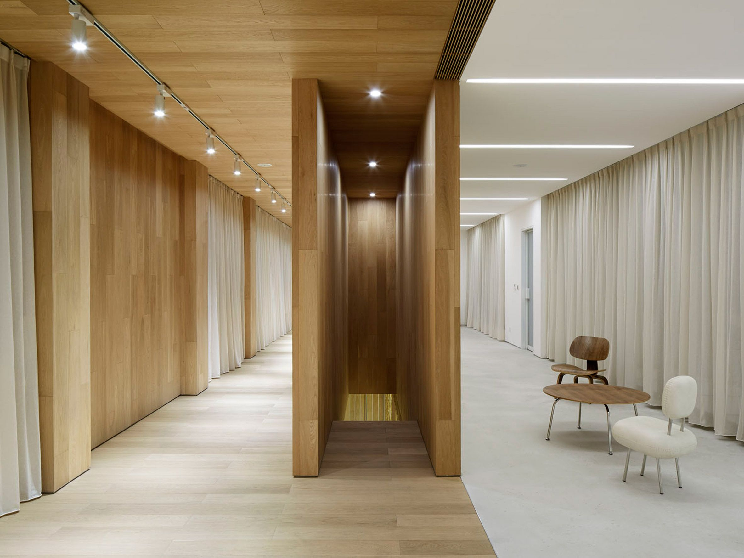 Sales office by team bldg corridor walkway interior wood cream spotlight track linear contrast hotel luxury office