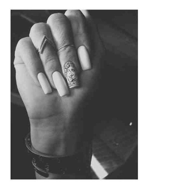 Kylie Jenner flashes her Versace (yes really) designed nail art.