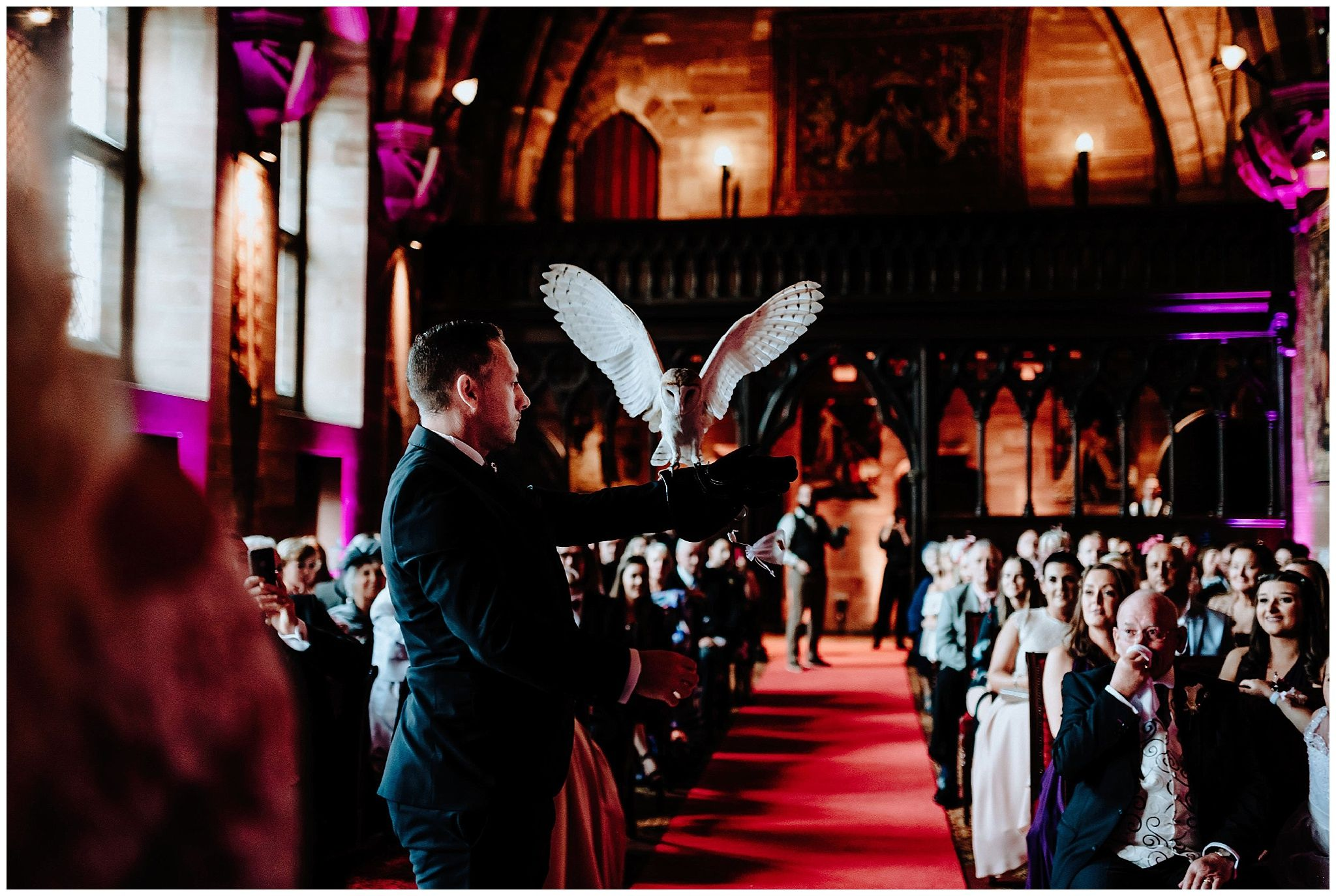 A owl ring bearer at a Cheshire Peckforton Castle Wedding captured