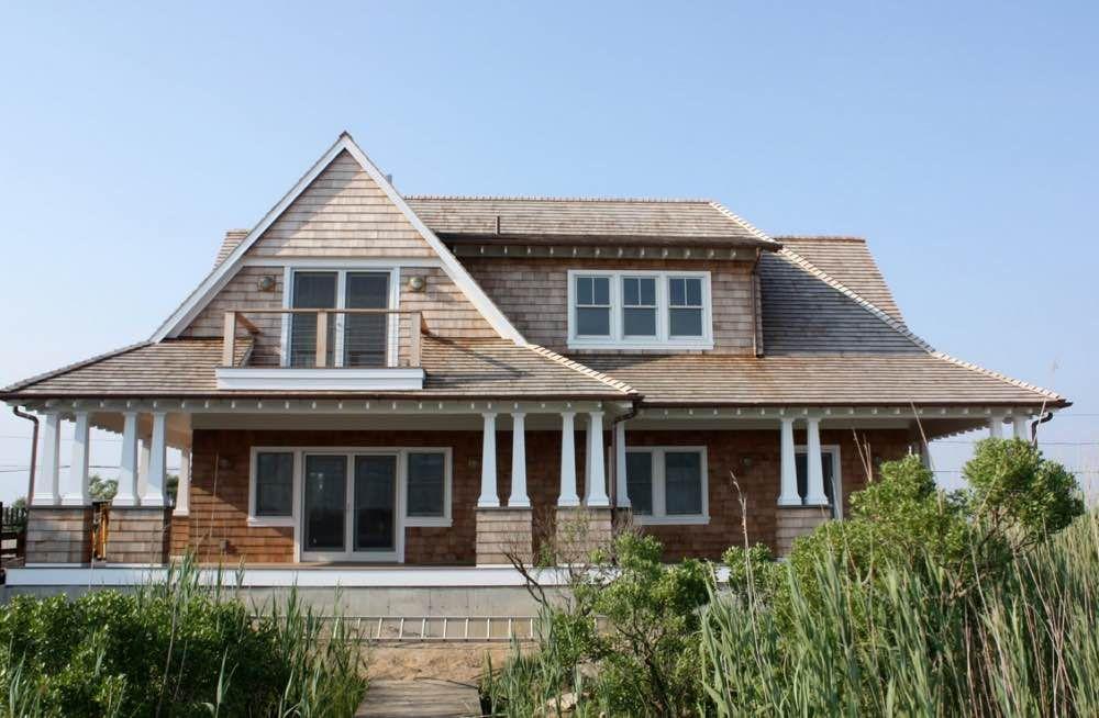 Bonnet roof on a house with wood shingle siding in cape for Beach house siding ideas