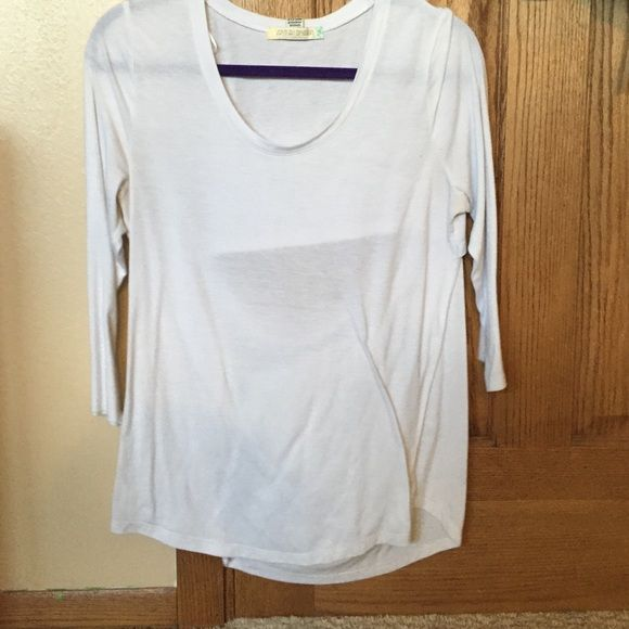 white shirt very nice and light! perfect for working out! I've only worn a few times, there is an opening in the back that is really cute Tops Tees - Long Sleeve