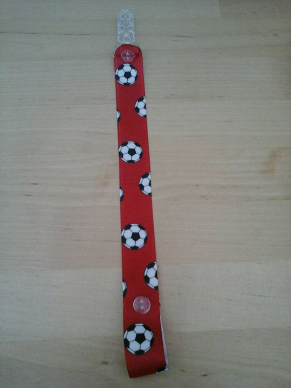 Check out this item in my Etsy shop https://www.etsy.com/uk/listing/257752360/red-football-clip-strap