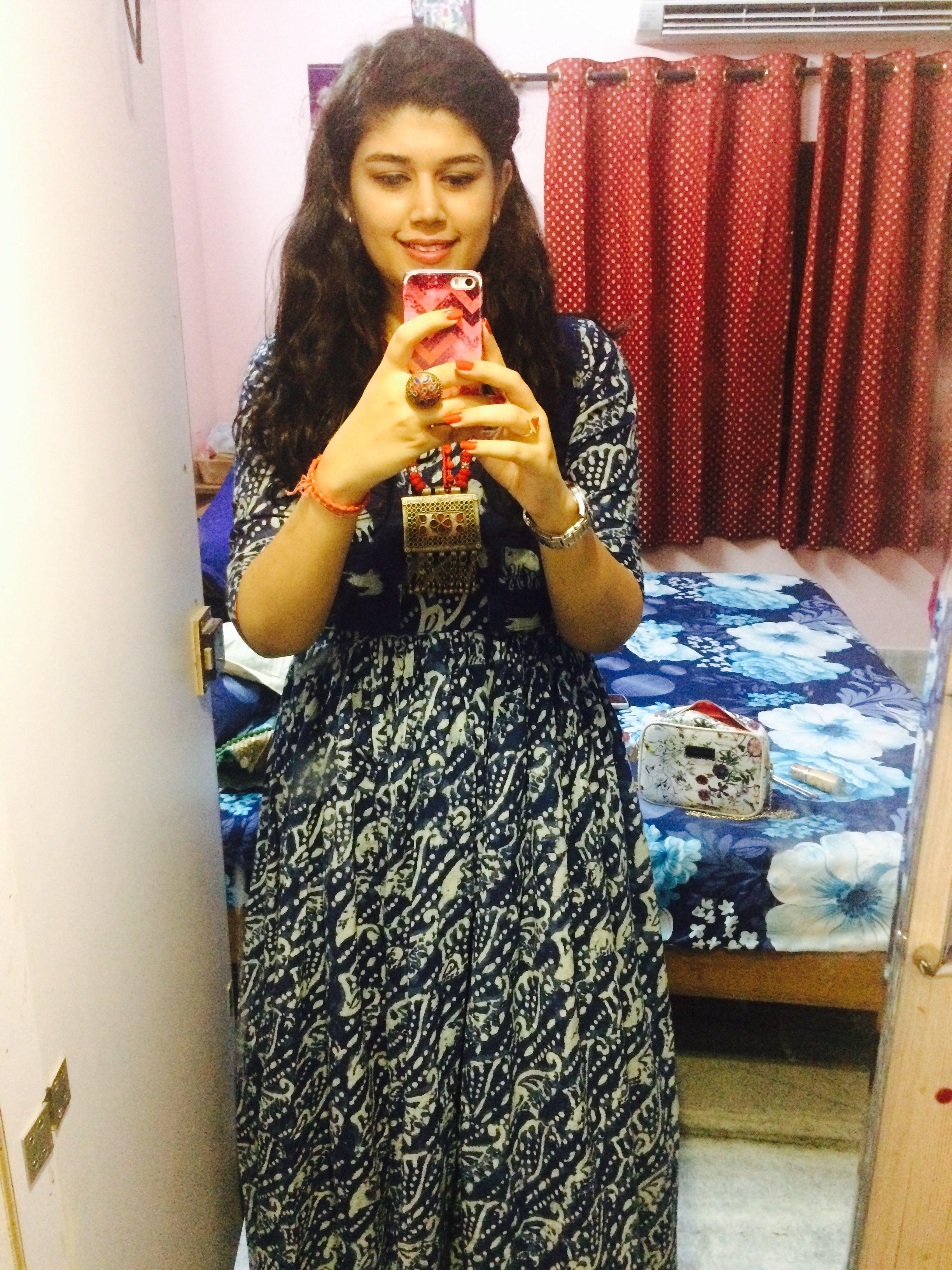 Indigo color maxi dress paired with indigo color koti and a afgani