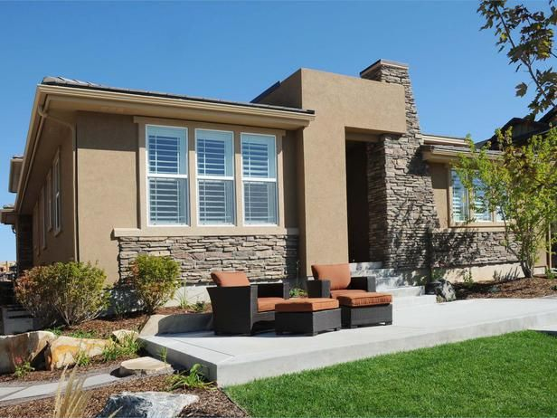Modern marvel stone cladding adds texture to the stucco for Stucco stone exterior designs