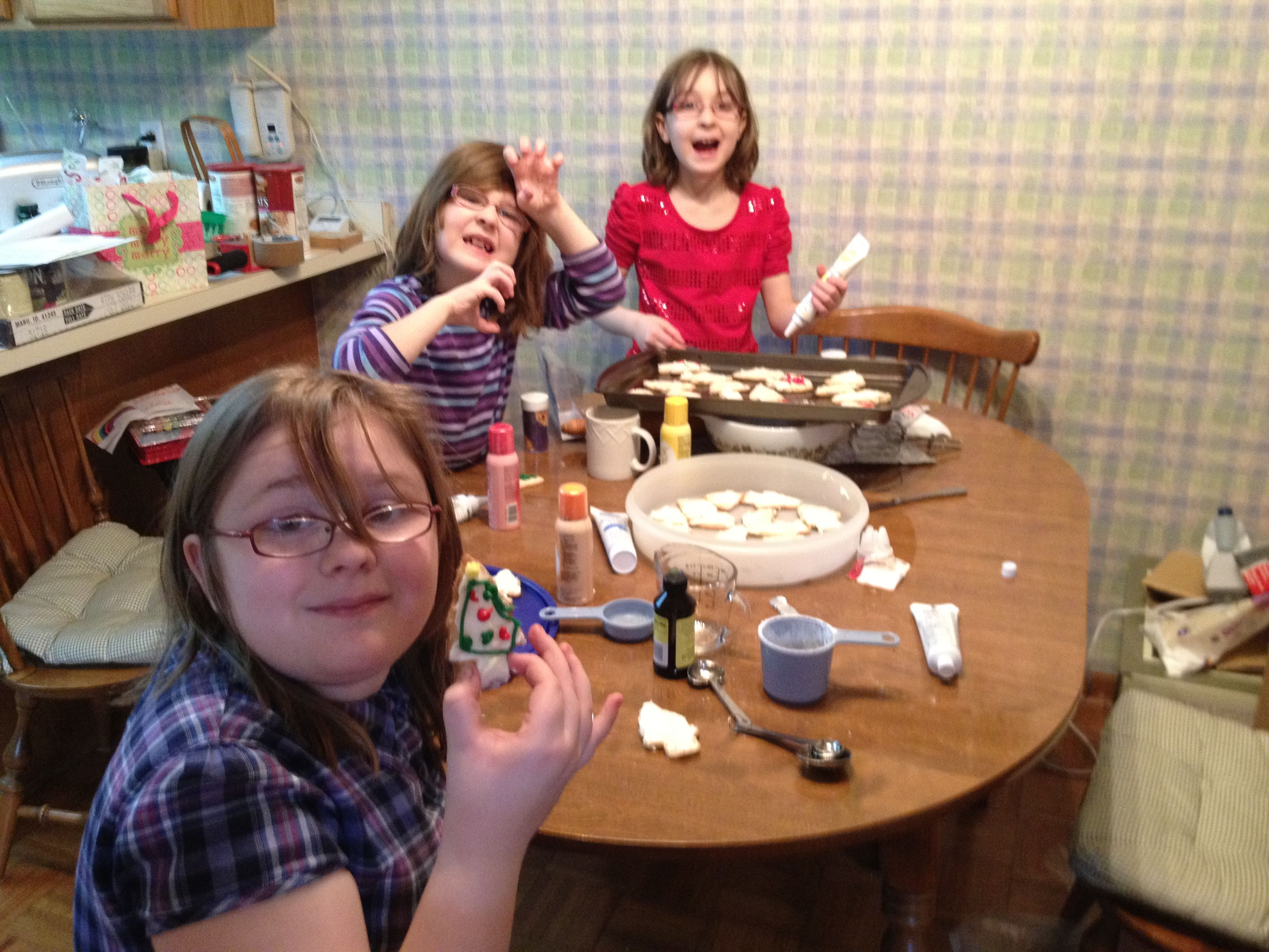 Gabrielle, Aydan, and Aubreigh making cookies December 2011