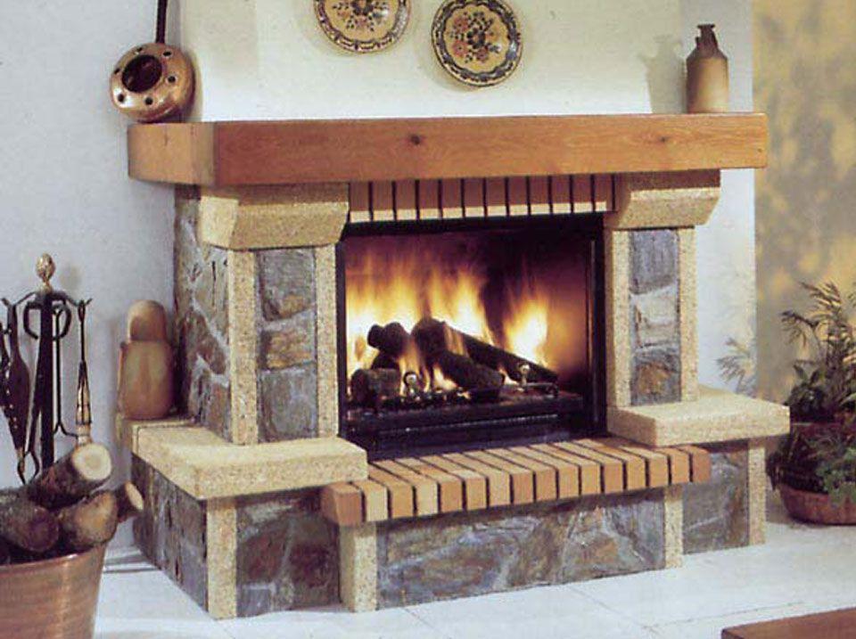 Chimenea rústica de piedra con hogar metálico decoración del hogar