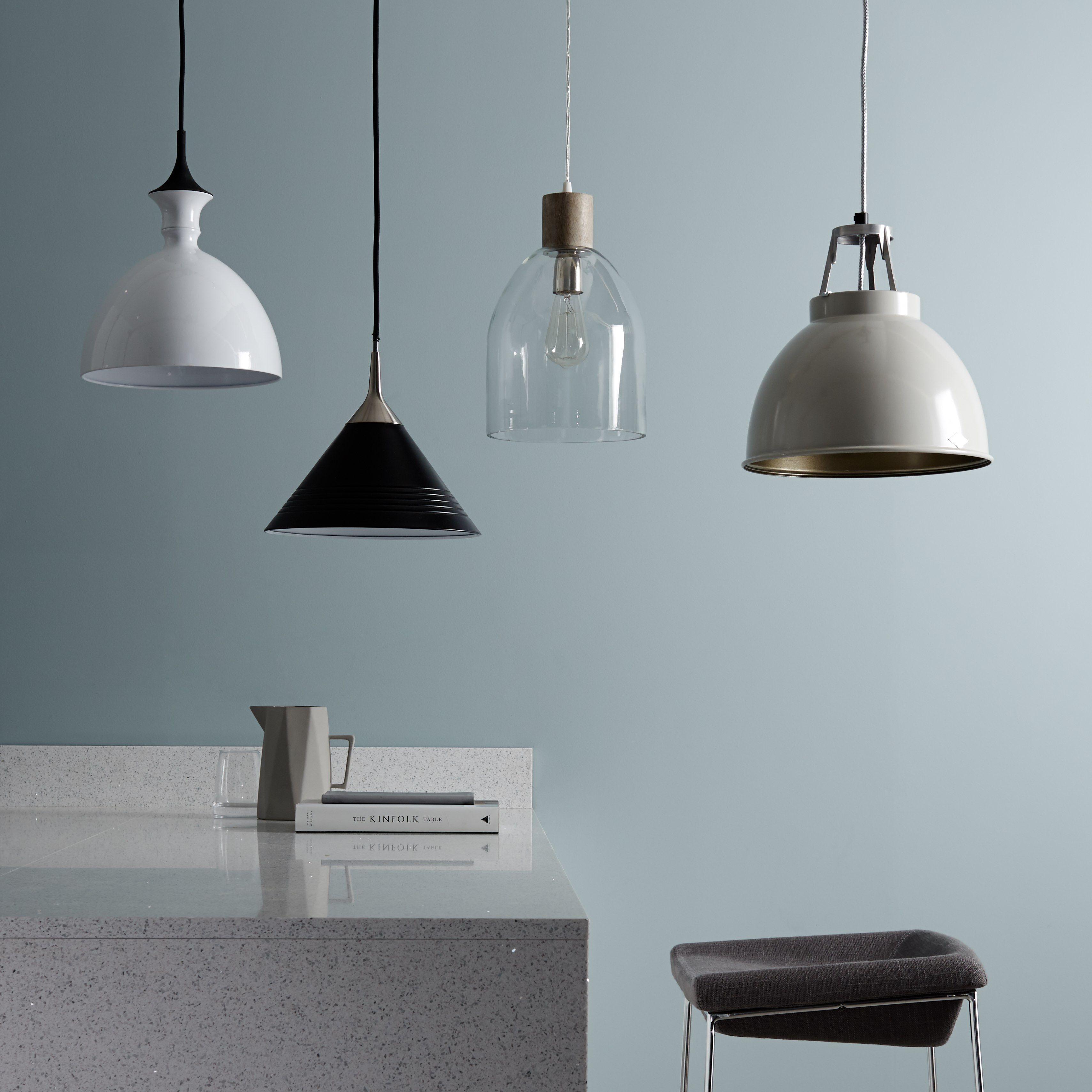 Sculptural and over-sized lighting provides a unique focal point to ...