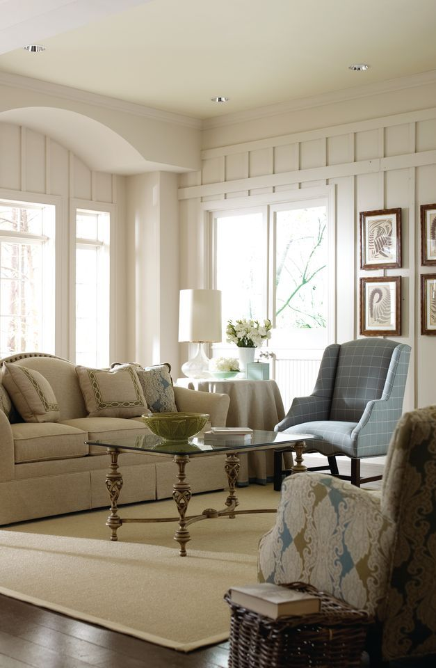 This contemporary cream living room was furnished by Pettigrew ...
