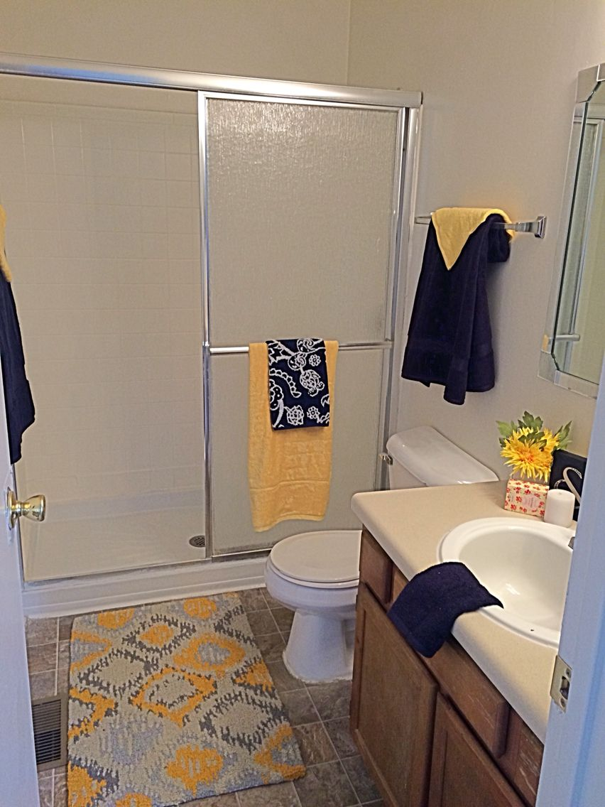 Apartment Mini Models Used Yellow And Navy To Brighten This Master Bath
