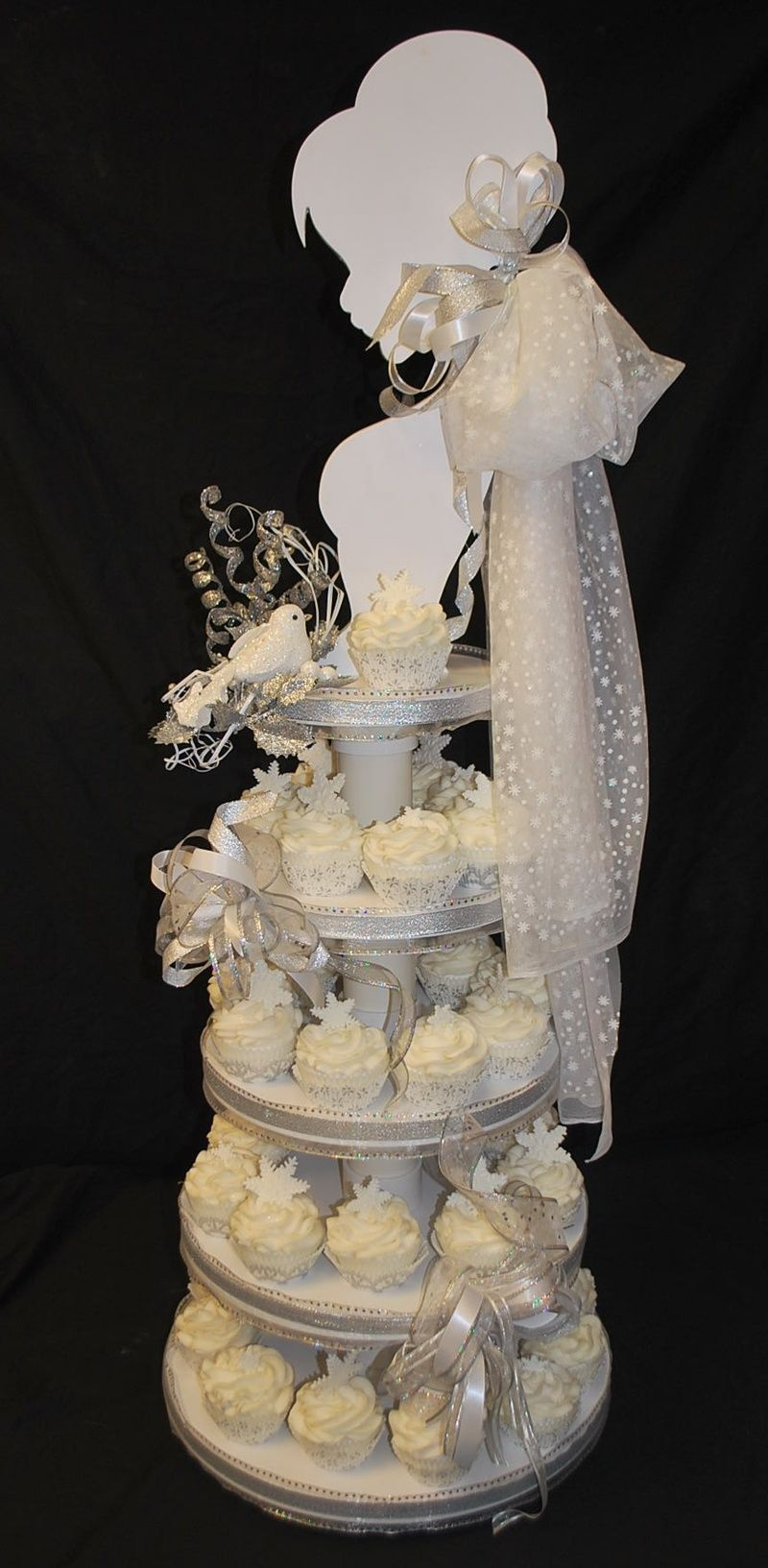 bride cupcake tower how cute with the snowflakes if i was having a winter wedding