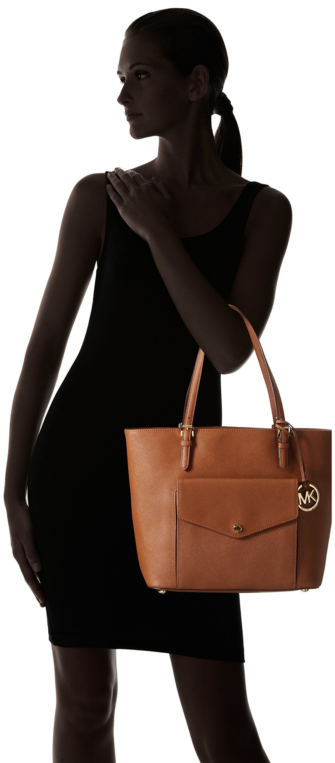 05dfeba52ad6 Michael Kors Jet Set Item Large Pocket MF Tote >>> Want additional info?  Click on the image. (This is an affiliate link) #MichaelKorsHandbags