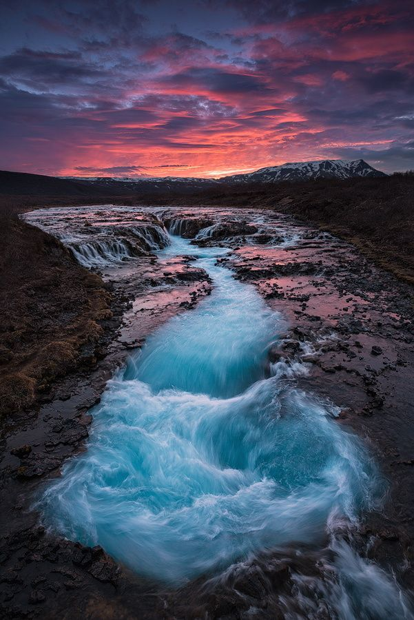 The cold water look as if it is freezing cold in its gorgeous icy light blue color. It is a beautiful optic effect, which you will see at several waterfalls in Iceland. bring your camera and catch it on film and photo. This waterfall is called Bruarfoss, and is located in South-West Iceland.