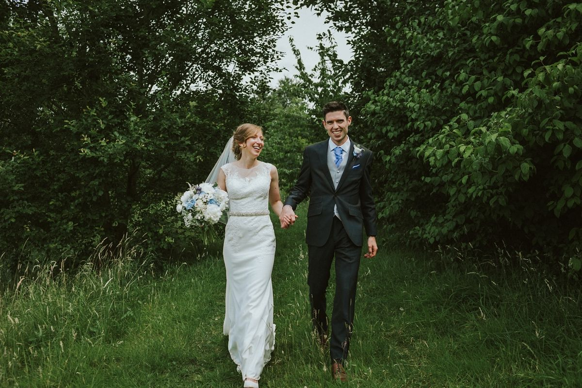 A ronald joyce gown for a rural and woodland inspired tipi wedding
