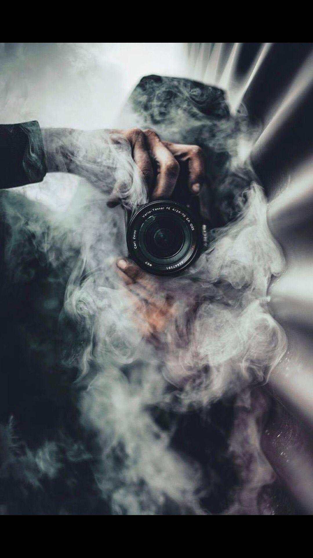 Love the smoke bomb effect around the camera! #creativephotography