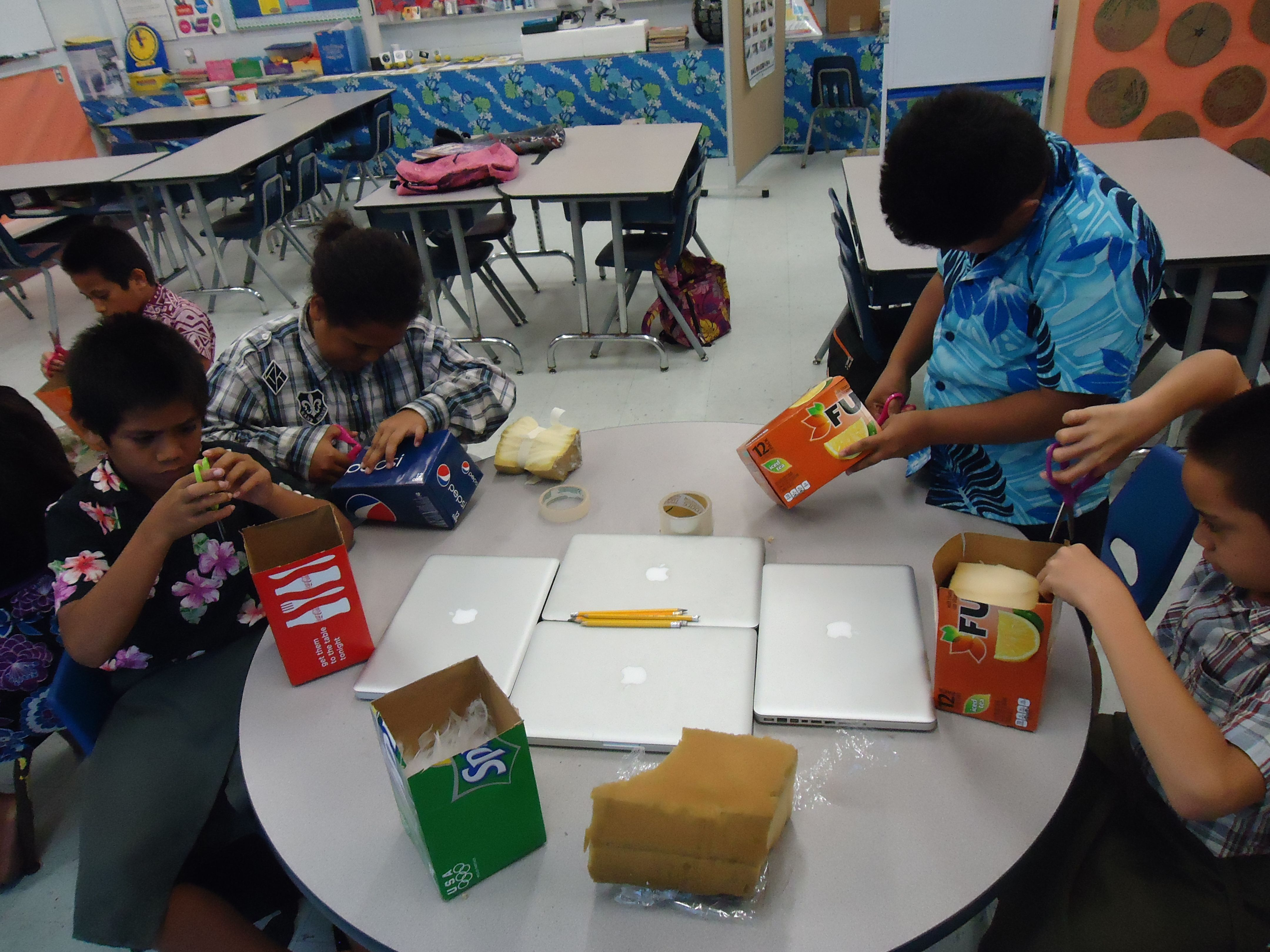 Kids Are Working On Their Egg Drop Experiment The